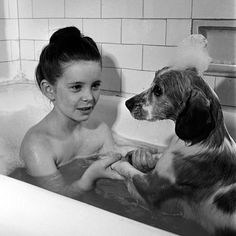 Child actress Margaret O'Brien shares a bubble bath with her spaniel, Maggie, in 1944. (Marie Hansen—The LIFE Picture Collection/Getty Images) #wildLIFEwednesday #NationalDogDay