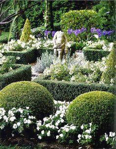 Statue anchors parterre garden