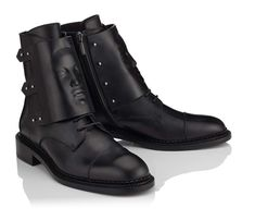 Black soldier boots with removable front 3D-panel. Order designer women shoes online with free worldwide shipping.