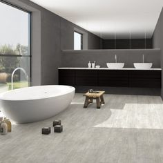 Ambient Click is a collection of beautiful vinyl tiles with an expressive tactile structure and fascinating colour variations The V-grooved tiles create a spacious perspective and enhance the authentic tile effect Thanks to the patented Uniclic . Wooden Flooring, Vinyl Flooring, Tile Effect Laminate, Vinyl Tiles, Travertine, Perspective, Colour, Bathroom, Create