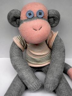 Lovely Monkey. I have lots of different colours in these cable-knit socks: pink, lavender, blueish-green, grey and pink, fawn and cream, and cream with fawn. She is £15 and £3 for items of clothing (plus p+p). I'll add a bow for free!