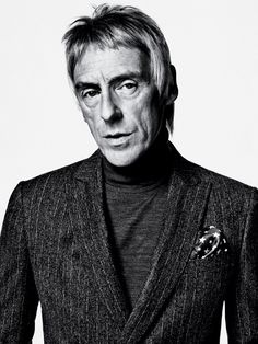 Paul Weller - John Smedley sweater, John Varvatos jacket, His own pocket square.  Photograph by Sebastian Kim. Fashion editor: Jason Rider. Fashion assistant: Elena Hale. Grooming by Andre Gunn at the Wall Group.