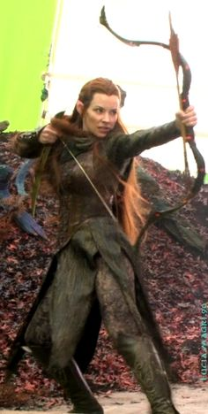 "Tauriel ""Spider Costume"". Olive green gown, leather bodice, bracers and boots…"
