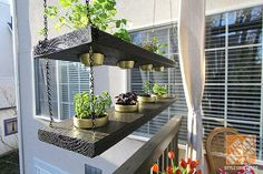 Deck Decorating Ideas: Hanging planters. Blogger Jen Stagg DIY'd this clever planter for her deck makeover. See it on The Home Depot Blog.