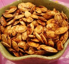 Roasted Pumpkin Seeds Recipes    Did mine with a little bit of olive oil, then sea salt, garlic powder and a pinch of cayenne.  delicious!