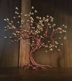 A personal favorite from my Etsy shop https://www.etsy.com/es/listing/294010105/wire-bonsai-tree