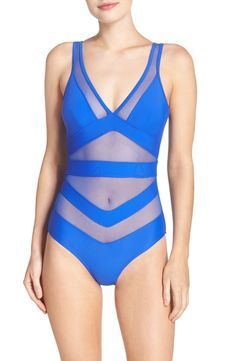 Hitting the beach in this bold one-piece swimsuit.