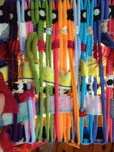 weaving---showing children how anything can be woven, take household or classroom materials and create a partition for your classroom