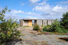 Architect Stein Halvorsen own retreat by the sea consists of three separate building sections under a unifying roof, sheltering the patio from the wind. The patio is perceived as a part of the cabi…