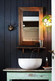 love the dark wall, the old cabinet, vessel sink on an antique... very similar to my plan!