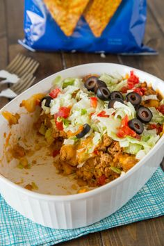 Doritos Taco Casserole can be topped with your favorite taco ingredients. Try cheese, salsa, avocado--whatever you like! Doritos Taco Casserole can be topped with your favorite taco ingredients. Try cheese, salsa, avocado--whatever you like! Doritos Taco Casserole Recipe, Casserole Dishes, Casserole Recipes, Dorito Taco Bake, Doritos Recipes, Taco Salad Doritos, Spicy Doritos, Recipes, Hors D'oeuvres