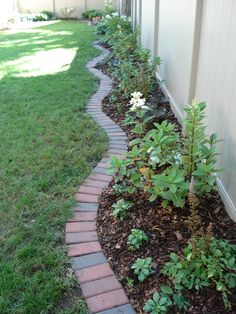 "Brick edging – traditional 4"" x 8"" clay bricks create an outstanding edging."