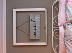"DIY over bed decor. ""Dream"" wrapped canvas hung with rustic jute from an antique wood window."