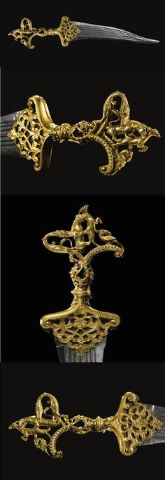 A magnificent Deccani ruby-set dagger with gilt-copper zoomorphic hilt, India, second half 16th century.