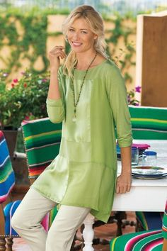 Spice up any day's journey with this exquisite tee. A sumptuous patchwork of pure silk overlays the front in a mélange of textures - crinkle chiffon, crêpe de chine, satin and georgette - while the back and sleeves drape comfortably in a soft and fluid knit. Slight high/low hem, with boat neck and long sleeves. Silk Road Tunic - Item #29955