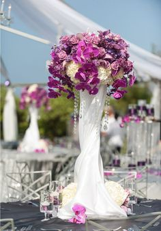 gorgeous shades of purple in a towering centerpiece design.  yvonne design.  hydrangea, roses, calla lilies, orchids, lilac
