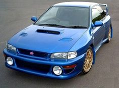 SUBARU IMPREZA, for now takes the backseat as the garage's king. the GTR 2013 takes your place, babe. Subaru Cars, Subaru Models, Subaru Impreza Sti, Wrx Sti, Cool Sports Cars, Sport Cars, Classic Japanese Cars, Subaru Legacy, Rs6
