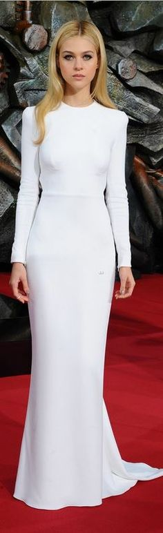 Who made Nicola Peltz's white long sleeve gown that she wore in Berlin on June 29, 2014