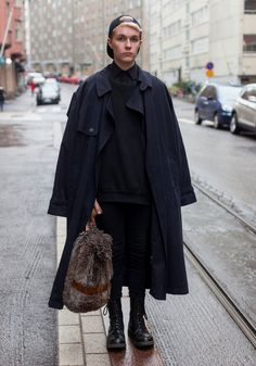 "Jori, 20. ""I wanted to wear dark colours and something comfortable. The coat and the bag are second hand."""