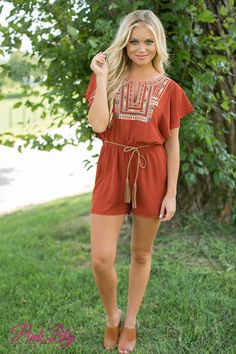 This stylish romper is such a beautiful way to celebrate the last days of summer and to transition into fall! This romper features all of the trending colors for fall, from the dark rust orange fabric to the forest green, gold, orange, and cream on the bodice! It's such a stunning color combination!