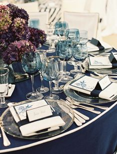 Light blue glassware adds an ethereal feel to this sophisticated dinner tablescape