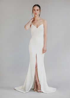 "Aesling | ""Elysian"" Available at Sash & Bustle #sashandbustle #aeslingbridal #canadiandesigner #crepegowns #crepeweddingdress #fittedweddingdress #bridalgowns #classicweddingdress #chicweddingdress #fittedcrepeweddingdress #shoplocal #sustainableweddingdresses #dresswithslit #uniqueweddingdress #modernweddingdress #minimalistweddingdress"