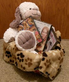 Dog-themed basket includes an adorable stuffed dog that's oh-so-soft, pet-themed movies, and a soft paw print blanket.