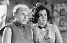 Rick Moranis and Rosie O'Donnell in The Flintstones Elizabeth Perkins, Rick Moranis, Rosie Odonnell, O Donnell, Universal Pictures, Marines, Picture Photo, Einstein, Couple Photos