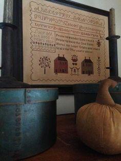 old blue/green pantry's, old hog scraper candlesticks. sampler and pumpkin by me.