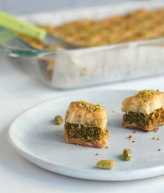 The intense smell of melted butter began to swirl in my tiny apartment. I peeked into the oven to assure that the little diamond shaped baklava pieces were nicely bronzed and crisp. I knew it was t…