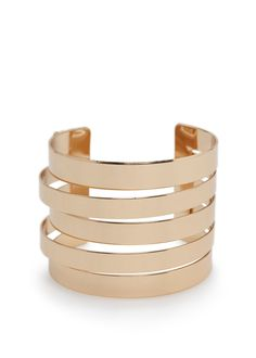 This cuff will add the perfect amount of bling to any minimalist look // Mango  Cut-Out Metal Cuff in Gold