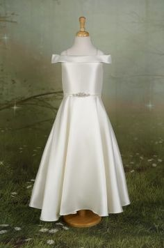 49436ecfa Elegant Mikado flower girl dress with pleated skirt, silver lace and  beading at the neckline, and buttons to the hem. Available in Ivory/silver  only