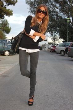 Grey skinnies with a crisp white shirt topped with a simple black crew neck sweater.