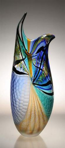 This is an awesome piece of glass as art! It has it all- from form and design to color. the person who created this should be extra proud- all justified!
