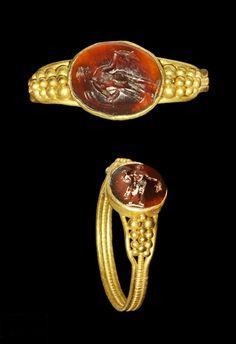 Roman Gold Ring with Carnelian Mercury Intaglio,  2nd-3rd century AD