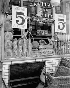 Berenice Abbott (1898–1991) - Bread Store, 259 Bleecker Street (1937) -  Gelatin silver print - Museum of the City of New York, 49.282.57