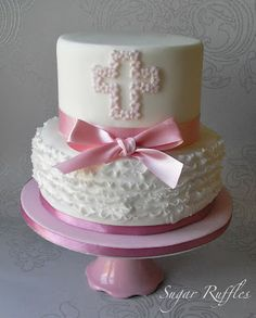 Her Christening cake will have white ruffles on the bottom like this one, and a Gray satin bow!