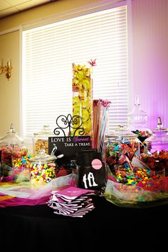 our colorful candy buffet!  we worked so hard to create all the details! a lot of DIY involved! :)  #candy buffet