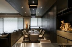 The dining room, tucked right behind the sofa, is the perfect size for a small dinner party. Upholstered dining chairs and a dark wood table, highlighted by the creative overhead lighting, are simple and stylish. Of course, a formal dining table is not the only option, with a subtly reflective breakfast bar providing another, casual option.