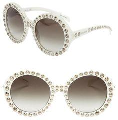 aab890fa0d7c Prada SPR29Q Oversized Sunglasses. Free shipping and guaranteed  authenticity on Prada SPR29Q Oversized Sunglasses at