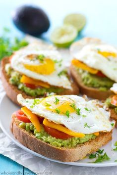 Avocado toast is given a fun California-style twist! This ultimate breakfast toast is piled with lots of smashed avocado, fresh veggies, and a beautiful fried egg on top. /WholeHeavenly/