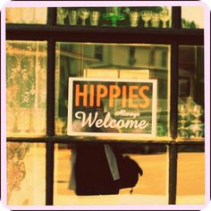 Hippies Always Welcome sign in doorway, by auntsmack4u at flickr. [You can buy the same Hippies Always Welcome sign here: http://www.allposters.com/-sp/Hippies-Always-Welcome-Posters_i8179852_.htm?aid=819750346]