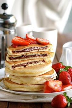 Nutella Stuffed Pancakes - frozen Nutella discs makes it a breeze to make these Nutella stuffed pancakes! by Kelly Jelic