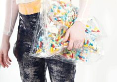 pill purse and foiled trousers