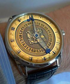 DeBethune DB25 IX Maya watch. Features a gold long count Tzolkin calendar ring.