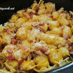 1	(32 oz.) bag frozen tater tots  1	(3 oz.)bag bacon pieces  1	pound boneless, skinless chicken breasts, diced  2	cups shredded cheddar cheese  ¾	cup milk salt & pepper, to taste