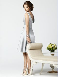Dessy Collection Style 2852          Fabric: Matte Satin purchase swatch        Sleeveless cocktail length matte satin dress with bateau neckline and deep cowl at back. Self belt at natural waist. Half circle skirt. Also available full length as style 2853. Sizes available 00-30W, and 00-30W extra length.