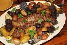 Pork loins with a balsamic-cabernet reduction with rosemary oven roasted potatoes, and mushrooms. To die for!