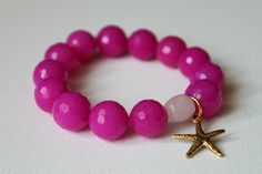 SALE 30% off Starfish bracelet - brilliant, bright hot pink jade stones, rose quartz and gold plated starfish. $17.50, via Etsy.