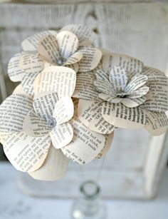 For Amy: Set of 3 Paper Flowers Upcycled From Rustic Vintage Book - Wedding Decoration, Bridal Decor, Centerpieces, Favors. $13.50, via Etsy.
